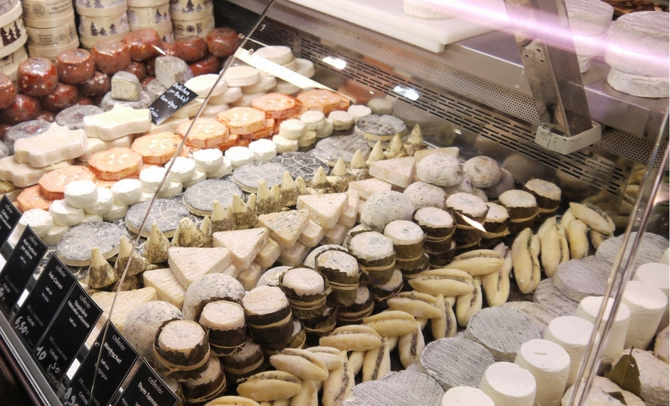 You can find all kinds of cheese at Cellerier at Les Halles De Paul Bocuse