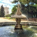 Fountain decorated with fish at the Sabatini gardens in Madrid, Spain