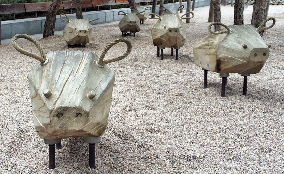 Charming wooden wild boar in park in Madrid