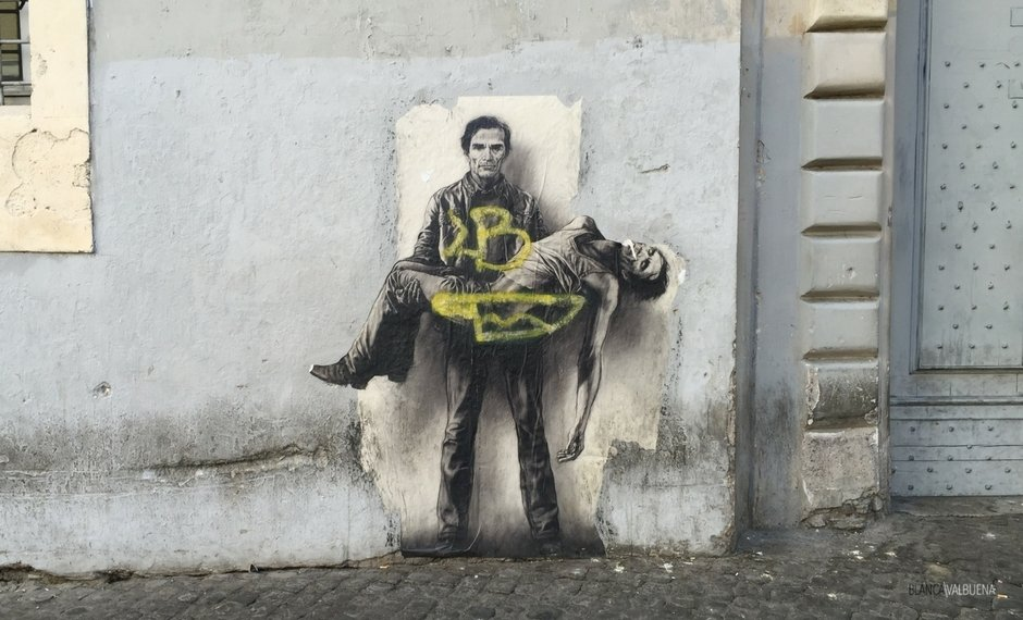 Street art that looks like Pieta in Rome but is two men