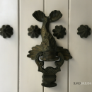Marine themes on Cartagena's door knockers signify the merchant class