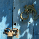 A colorful large antique door with a reptilian motif as a door knocker