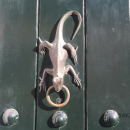 A gold lizard on an antique door in Cartagena